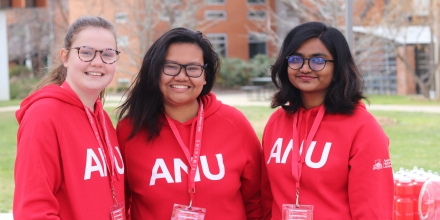 Three female engineering students wearing red ANU jumpers