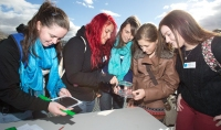 Five girls inspect solar cells