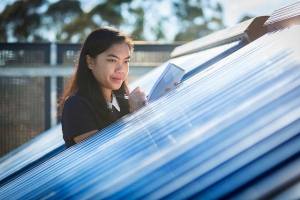 Female student looks at solar panels